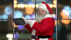 Authentic Santa Claus presenting digital tablet. Old traditional Santa holding modern computer tablet and giving thumb up. Perfect gift for winter holidays stock video footage