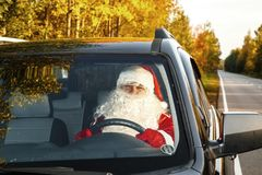 Authentic Santa Claus. Santa Claus drives a car. Authentic Santa Claus. Santa Claus drives a car through the autumn forest. Waiting for Christmas Royalty Free Stock Photography