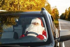 Authentic Santa Claus. Santa Claus drives a car. Royalty Free Stock Photography