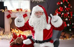 Authentic Santa Claus showing funny gestures. Indoors stock images