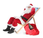 Authentic Santa Claus sitting on a beach chair Stock Photography