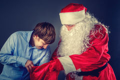 Authentic Santa Claus with a teenager. Stock Images