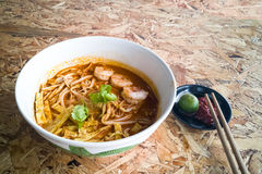 Authentic Sarawak laksa noodle with prawn and egg strips Stock Photos