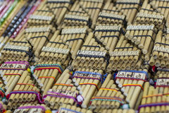 Authentic south american panflutes in local market in Peru. Stock Image