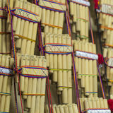 Authentic south american panflutes in local market in Peru. Royalty Free Stock Photo