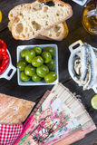 Authentic spanish tapas selection on wooden table from above Stock Photo