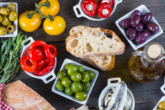 Authentic spanish tapas selection on wooden table from above Stock Photography