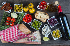 Authentic spanish tapas selection on wooden table from above Royalty Free Stock Images