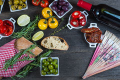 Authentic spanish tapas selection on wooden table from above Stock Image
