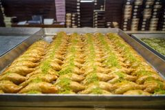 Authentic sweet Baklava, traditional turkish famous delicious dessert in tray showcase of local shop in Istanbul. Turkey Royalty Free Stock Images