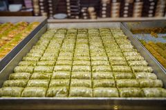 Authentic sweet Baklava wrap, traditional turkish famous delicious dessert in metal tray showcase of local shop in Istanbul. Turkey Stock Photo