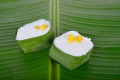 Authentic Thai dessert, Creamy Coconut Tapioca and Corn Pudding. On green banana leaf background Stock Photos