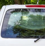 Authentic trace after being shot with rifle on the rear window of car Royalty Free Stock Photos