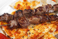 Authentic Turkish shish kebab with pita bread. Close up to authentic Turkish shish kebab with pita bread Stock Photo