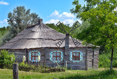 Authentic Ukrainian ancient house with thatched roof. Royalty Free Stock Image