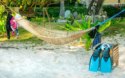 Authentic view of snorkeling equipment drying near a traditional. Authentic view of snorkeling equipment, fins and tube, near a traditional hammock on a tropical Stock Photos