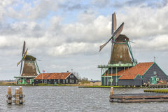 Authentic windmills in Holland. Authentic windmills at the Zaanse Schans in the Netherlands with stormy clouds behind it Royalty Free Stock Image