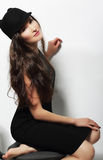 Authentic Woman in Black Dress and Woolen Cap Stock Image