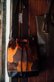 Authentic women`s leather bags and purses in a handmade shop. Royalty Free Stock Images