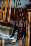 Authentic women`s leather bags and purses in a handmade shop. Royalty Free Stock Image