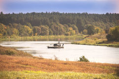 Authentic wooden ferry through the Neris river, Lithuania Royalty Free Stock Images