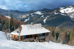 Authentic wooden house in winter mountains Stock Photography