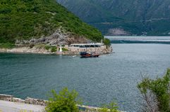 Authentic yacht sails past Verige 65 in the bay on a background of mountains royalty free stock image