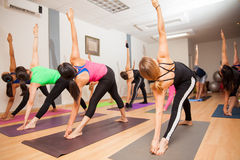 Authentic yoga class in progress Stock Photos