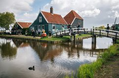Authentic Zaandam mills and traditional vibrant houses on the water canal in Zaanstad village, Netherlands Royalty Free Stock Photography