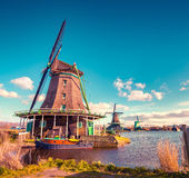 Authentic Zaandam mills on the water channel in Zaanstad village Royalty Free Stock Photo
