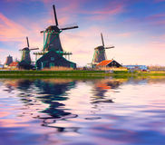 Authentic Zaandam mills on the water channel in Zaanstad willage Stock Photography