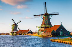 Authentic Zaandam mills on the water channel in Zaanstad willage Stock Photos