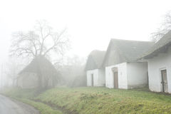 Authentical village houses in fog.landskape Stock Photo