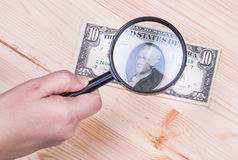Authentication of ten dollars banknote Royalty Free Stock Photos