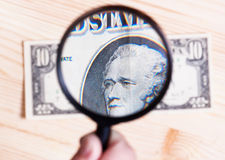 Authentication of ten dollars banknote Royalty Free Stock Photo