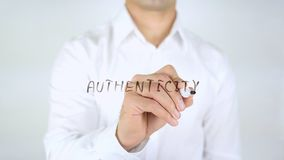 Authenticity, Man Writing on Glass, Handwritten. High quality stock image