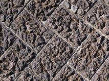 Authentische alte und raue strukturierte gepflasterte Backsteinmauer Lizenzfreies Stockfoto