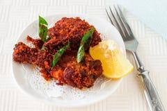 Authentischer indischer Hühnerfischrogen mit Gewürzen, Curryblatt und Kokosnuss Stockbild
