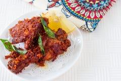 Authentischer indischer Hühnerfischrogen mit Gewürzen, Curryblatt und Kokosnuss Lizenzfreies Stockbild