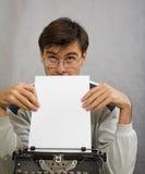 Author. Man with typewriter thinking about new novel Royalty Free Stock Photos