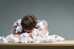 Author lying in the heap of paper Royalty Free Stock Photography
