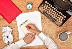 Author make notes in a notebook Royalty Free Stock Photos