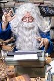 Author senior. Author working on a old typewriter royalty free stock image