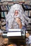 Author senior. Author working on a old typewriter stock photo