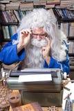 Author senior. Author working on a old typewriter stock image