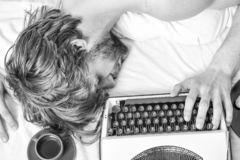 Author tousled hair fall asleep while write book. Workaholic fall asleep. Man with typewriter sleep. Deadline concept stock photo