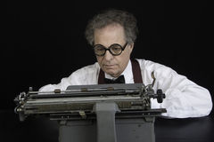 Author working on Antique Typewriter Royalty Free Stock Photography