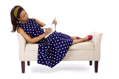 Author Writing in Diary. Black female in vintage clothing writing on a diary on white background Stock Photos