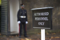 Authorised personnel only sign. With guard in the background Stock Image