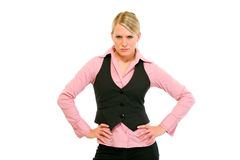 Authoritative business woman with hands on hips Stock Images